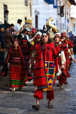 Officials parade ahead of a golden puma during street processions for Inti Raymi festival, Cusco, Peru