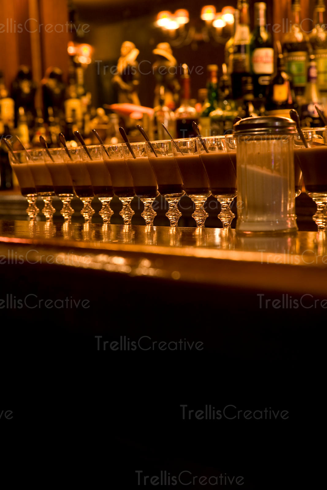 Several cocktails lined up on restaurant bar