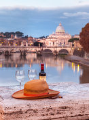 Hat with wine glasses and wine bottle  on bridge near Basilica di San Pietro in Vatican, Rome, Italy