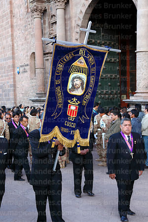 Member of the Brotherhood of Knights of the Lord of the Holy Sepulchre carrying banner outside La Merced church at start of G...