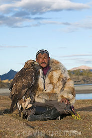Dalai Han an Kazakh eagle hunter with his Golden Eagle Bayan Ulgii in Altai Mountains western Mongolia