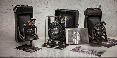 Three old cameras in a row