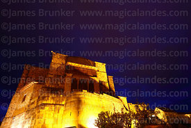 Santo Domingo church and Inca wall of the Coricancha / Sun Temple lit up at night, Cusco, Peru