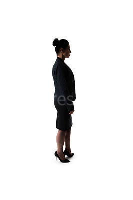 A woman, standing, in a black suit, in semi-silhouette – shot from mid level.