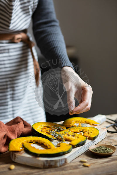 Woman cooking pumpking slices
