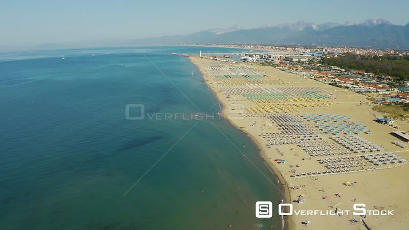 Aerial, large sand beach in the morning in Viareggio, Italy