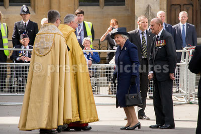The Queen and Prince Philip Smile broadly as they some of the Westminster Abbey Clergy