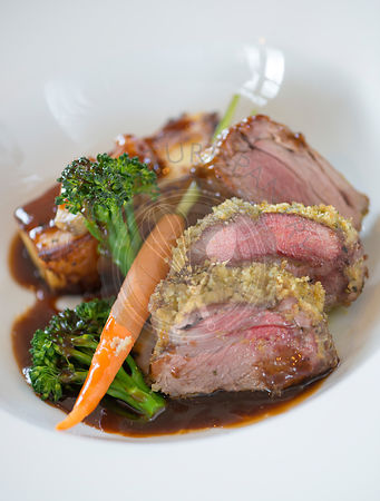 Roast rump of herb crusted Lamb.