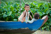 children playing on a boat on Tonle Sap Lake near Siem Reap, Cambodia