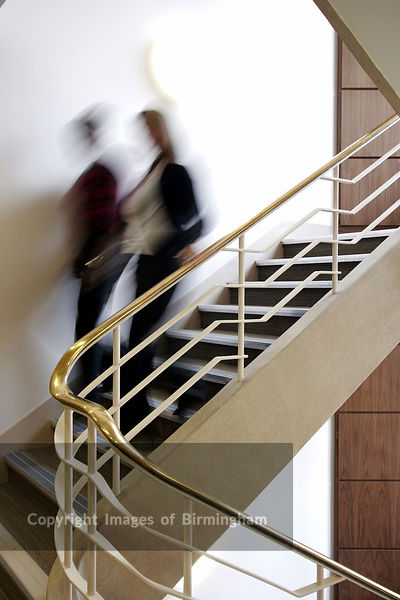 Business colleagues walking down a flight of stairs