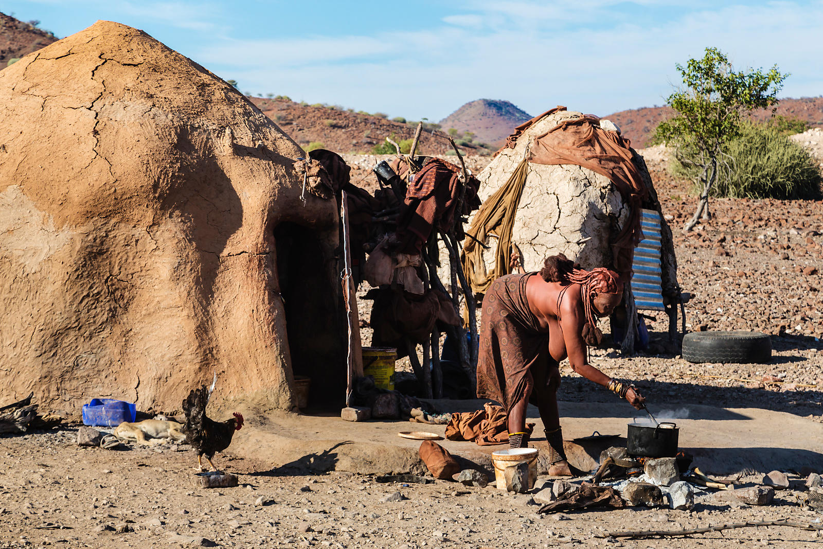 Himba Woman Cooking Miele pap over an Open Fire