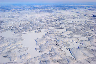 Aerial view of Mackenzie river and delta in winter, North West Territories, Canada April 2010