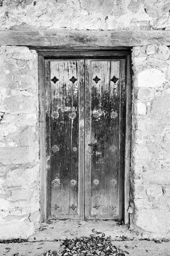 OLD DOOR MISSION SAN JUAN CAPISTRANO SAN ANTONIO TEXAS BLACK AND WHITE