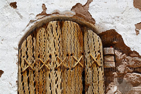 Detail of llama skin rope and cactus wood construction of door of San Lucas church belfry, Toconao, Region II, Chile