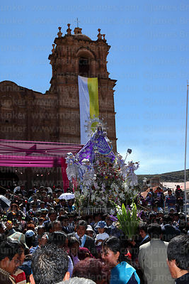 Virgen de la Candelaria in front of cathedral at start of main procession for festival, Puno, Peru