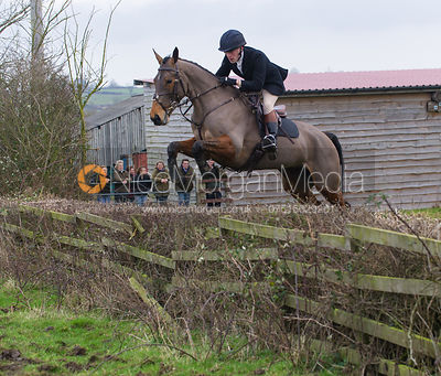 Simon Grieve jumping a hedge at Town Farm, Brooke