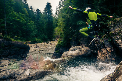 Germany, Bavaria, Allgaeu, young man canyoning in Ostertal