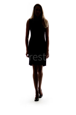 Silhouette of a woman walking towards the camera – shot from mid level.