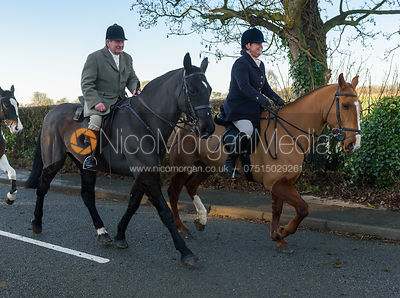 Michael Stokes, Julia Hallam Seagrave leaving the meet - The Cottesmore Hunt at Pickwell Manor 28/12