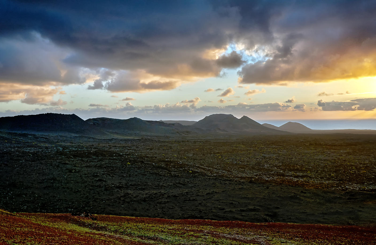 Sunset over the coast in Timanfaya national park, Lanzarote