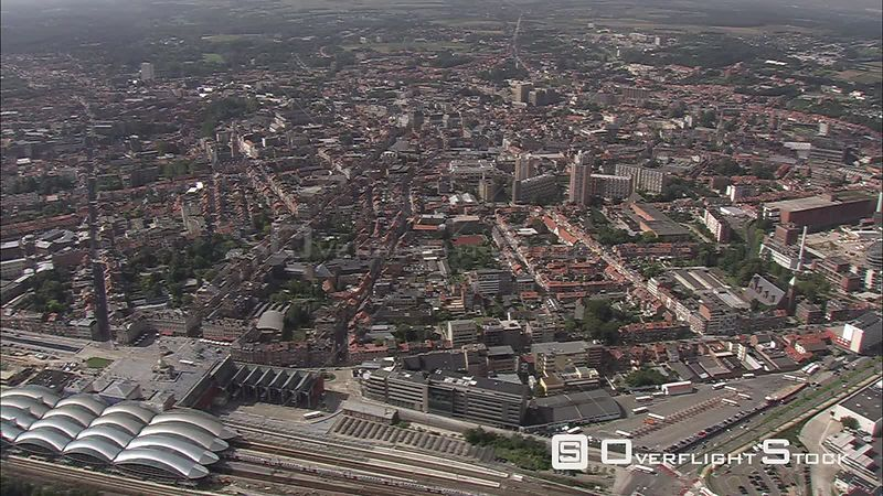 Flying past Louvain (Leuven), Belgium train station in lower frame