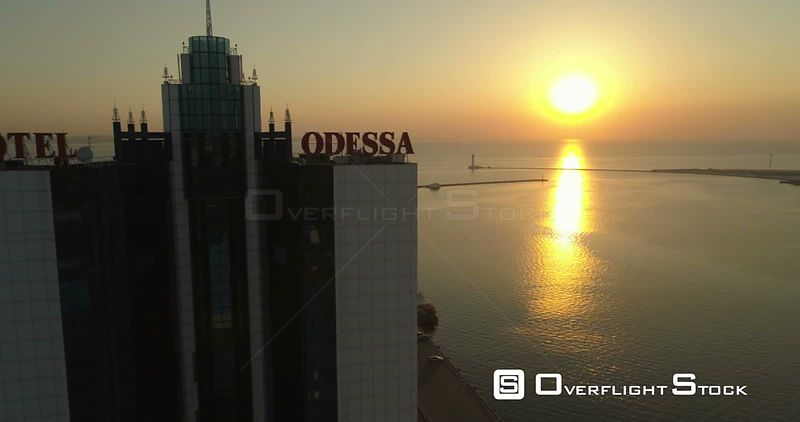 Drone flies towards the Odessa Hotel at sunrise showing the massive Odessa sign atop the hotel. Ukraine