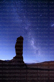Milky Way and Large Magellanic Cloud above Moai de Tara / Monjes de la Pacana rock formation, Los Flamencos National Reserve,...