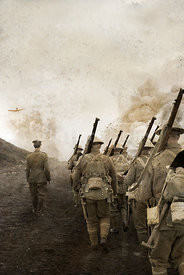 An atmospheric image of a British soldiers walking through no mans land surrounded by explosions and flying Debris, in WW1.