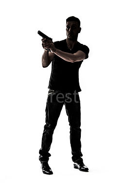 A mystery man, in silhouette, with a gun – shot from mid level.
