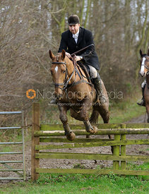 Russell Cripps jumping a hunt jump at Brick Hills