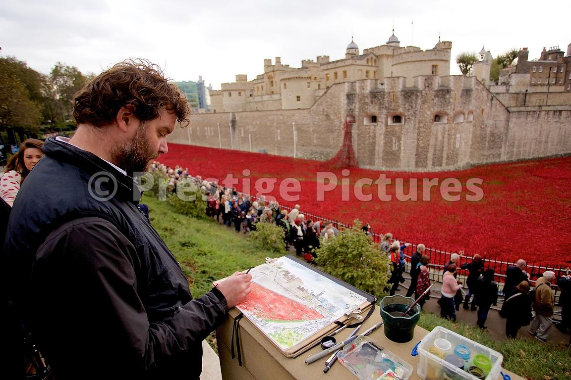 Artist Painting a Watercolour of The Blood Swept Lands and Seas of Red installation at The Tower of London