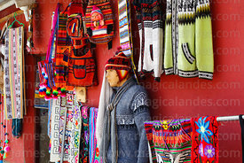Jumpers and textile souvenirs for sale outside shop on main square, Putre, Region XV, Chile