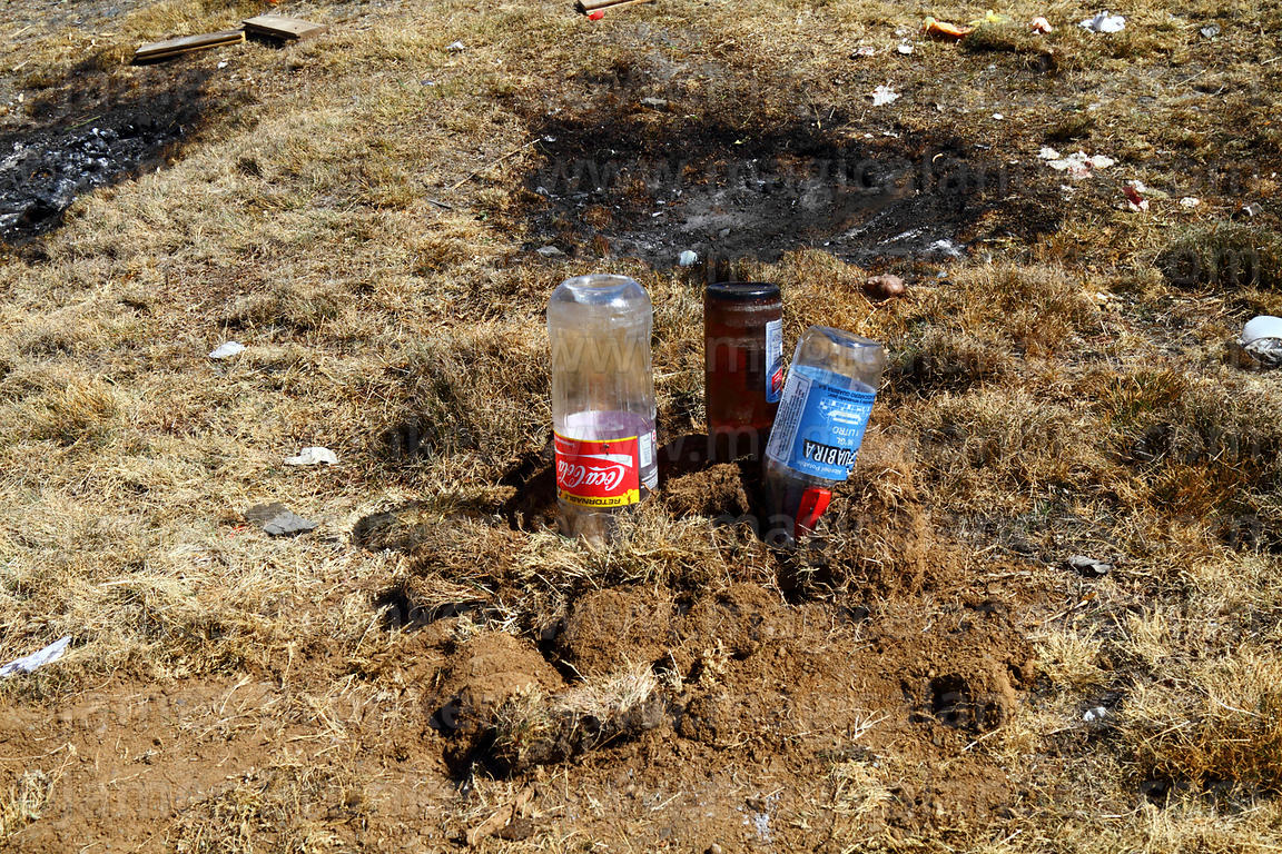 Upturned bottles left in the ground as offerings to Pachamama, Bolivia