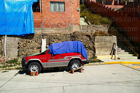 """Suspicious cars will be burned"" warning graffiti on wall in suburb, La Paz, Bolivia"