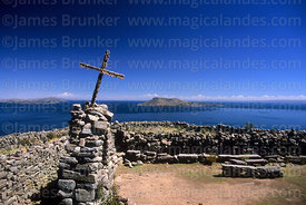 Cairn, cross and small archaeological site on summit of Taquile Island, Peru