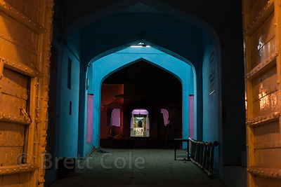 Nighttime view of a colorful entranceway to a hotel in Pushkar, Rajasthan, India.