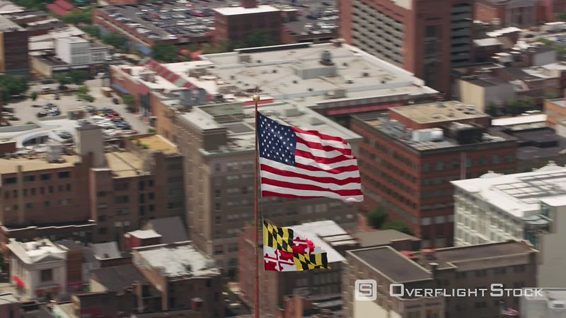 Baltimore, Maryland Aerial view of US Flag and Maryland State Flag on top of Schaefer Tower.   Shot with Cineflex and RED Epi...