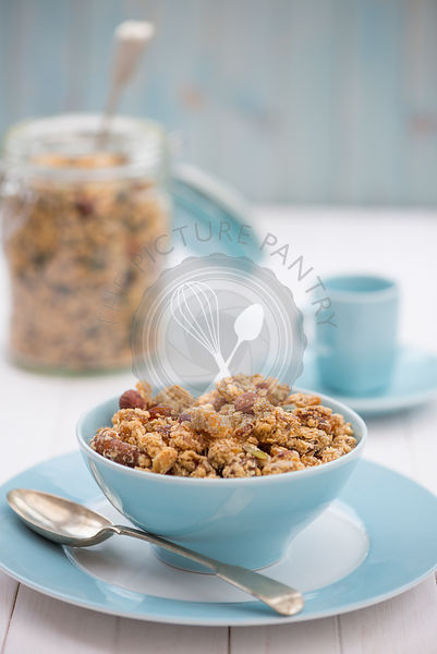 A breakfast of healthy granola, served in a bowl.